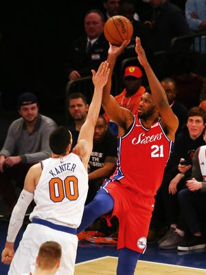 New York, NY, USA; Philadelphia 76ers center Joel Embiid (21) shoots the ball against New York Knicks center Enes Kanter (00) during the second half at Madison Square Garden.