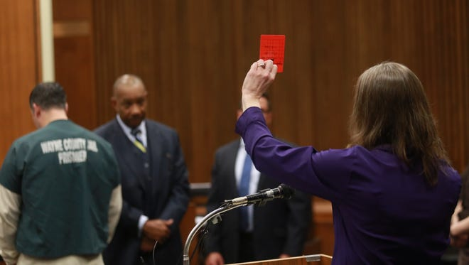 Kris Bieniewicz holds up a red card while giving a victim impact statement during the sentencing of Bassel Saad on Friday March 13, 2015. Saad attacked Bieniewicz's husband John Bieniewicz who was officiating at an adult league game in Livonia on Sunday, June 29, 2014.
