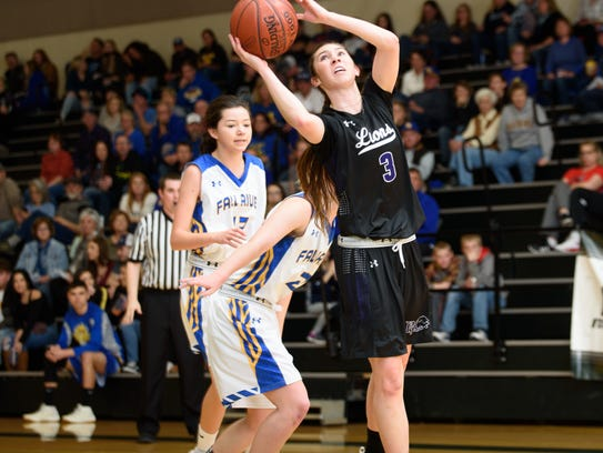 Redding Christian's Livi Lindsey, right, goes up for