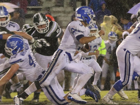White House's Carter Hunt carries the football against Greenbrier.