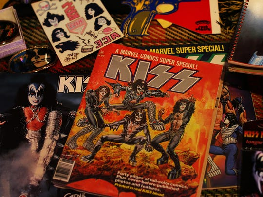 """Some of Brad Lemerond's most-prized KISS collectibles include the band's original comic book, the tattoos that came inside the """"Alive II' album and the paper Love Gun from the 1977 album of the same name."""