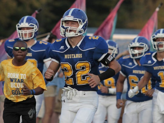 Quarterback Adam Wieczorek leads the team out for the Madeira Mustangs.  Madeira hosts Mariemont for their homecoming 2017 game on Friday, September 22nd.