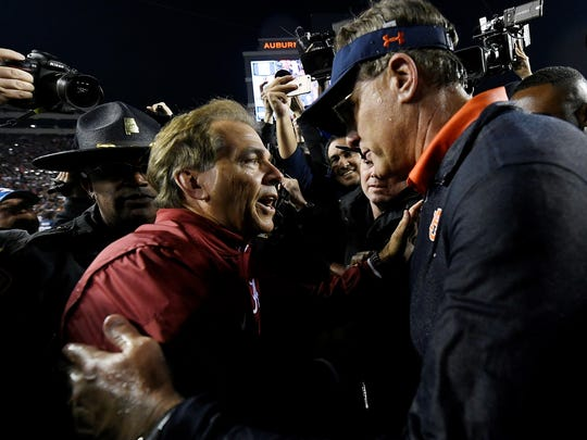 Alabama coach Nick Saban and Auburn coach Gus Malzahn shake hands after the game.