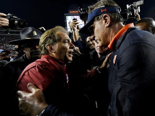 Alabama coach Nick Saban and Auburn coach Gus Malzahn