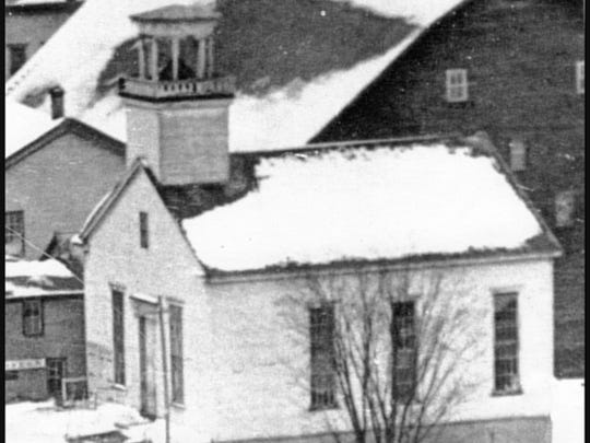 Oldest picture of the 1818 Town Meeting House in its current location in Stowe. This picture was taken in the 1890s when the building was used as the Town Hall and gymnasium.