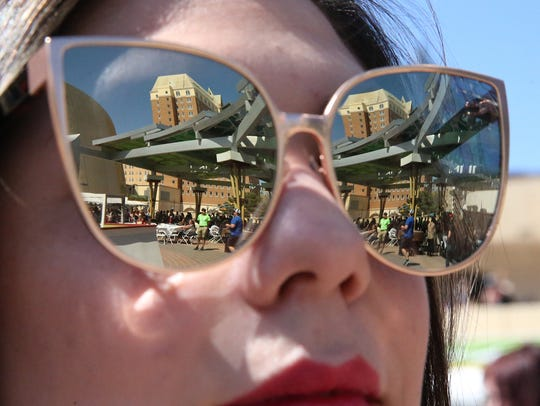 Downtown El Paso is reflected in the sun glasses of Alexandra Sotelo at last year's Sun City Craft Beer Festival.