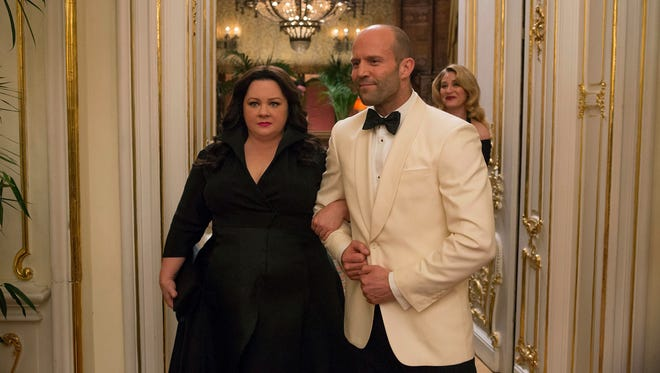 Melissa McCarthy and Jason Statham star as secret agents in 'Spy.'