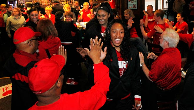 University of Louisville fans welcome the women basketball team as they wait to see where they will be playing in the NCAA tournament at the Sports and Social Club  in Louisville, Kentucky.        March 14, 2016.