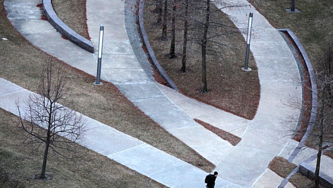 Wednesday, Jan. 15, 2014 A lone student walks through University of Cincinnati's campus, near Morgen's Hall, early morning Wednesday.  The Enquirer/ Liz Dufour