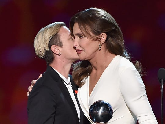Caitlyn Jenner accepts the Arthur Ashe Courage Award from former professional soccer player Abby Wambach onstage during the 2015 ESPYS.