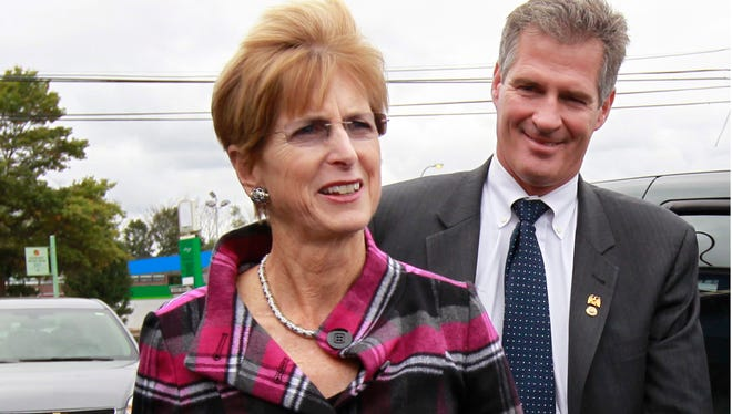 FILE: Former New Jersey Gov. Christine Todd Whitman, left, and U.S. Sen. Scott Brown, R-Mass., right, arrive at a banquet hall in Boston's Dorchester neighborhood Tuesday, Oct. 9, 2012. (AP Photo/Steven Senne)