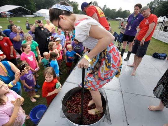 Jami Jackson represents the Pastafarians team as she competes in the grape stomping contest at the Memphis Italian Festival held at Marquette Park on June 2, 2016, in East Memphis.
