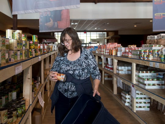 Sabrina Puckett stocks the shelves at a distribution