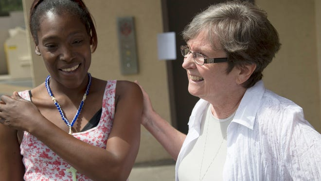 Sister Adele O'Sullivan (right), who is a medical doctor, talks with Tahoma Pace at Circle the City, a respite medical center for the homeless. O'Sullivan says the facility keeps patients from relapsing and provides a sense of community for residents.