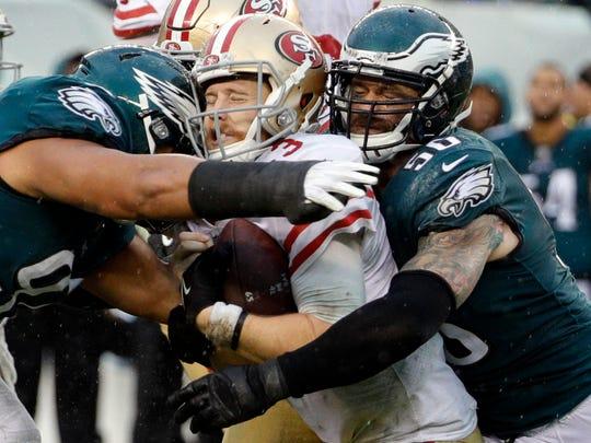 Philadelphia Eagles' Destiny Vaeao (97) and Chris Long (56) take down San Francisco 49ers' C.J. Beathard during the second half of an NFL football game, Sunday, Oct. 29, 2017, in Philadelphia.