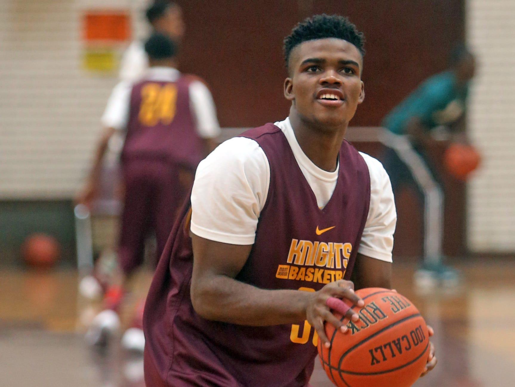 Mount Vernon High School basketball player Jamie Wiltshire shoots during practice Nov. 25, 2015.
