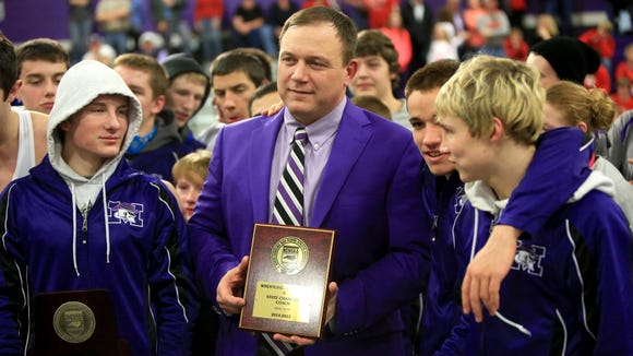 Mitchell coach Ed Duncan and his wrestlers.