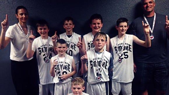 The Carolina Smoke fifth grade boys basketball team