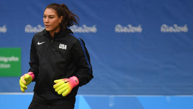 United States goalkeeper Hope Solo (1) warms up for the game against Sweden during the women's team quarterfinal in the Rio 2016 Summer Olympic Games at Estadio Nacional Mane Garrincha.