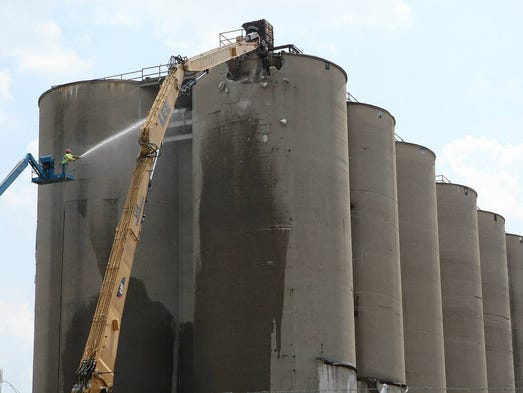 Iconic silos at the former Solae property are demolished at UofL.July 31, 2014