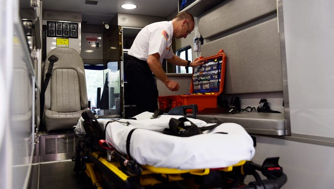 Jeff Jackson, Sandusky County EMS director, inspects an EMS truck in this News-Messenger file photo.