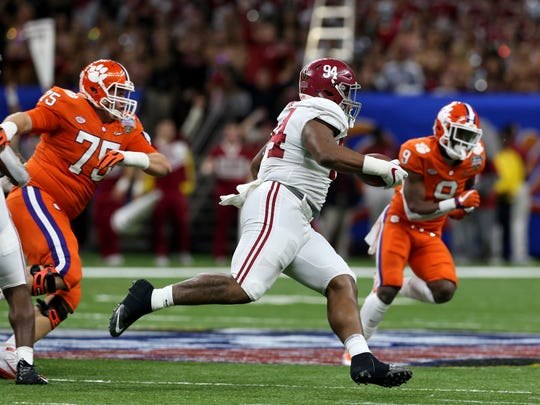 Alabama defensive lineman Da'Ron Payne (94) returns an interception in the second half of the Sugar Bowl semi-final playoff game against Clemson for the NCAA college football national championship, in New Orleans, Monday, Jan. 1, 2018. (AP Photo/Rusty Costanza)