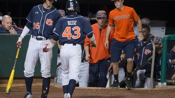 Auburn infielder/outfielder Hunter Tackett (36) high