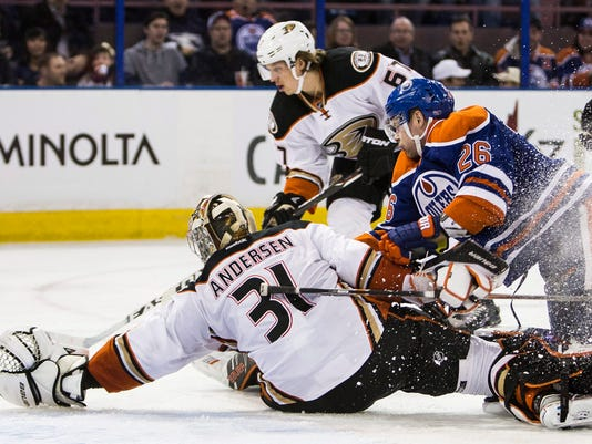 Anaheim Ducks' goalie Frederik Andersen (31) reaches back for the puck as Edmonton Oilers' Iiro Pakarinen (26) looks for a shot during the second period of an NHL hockey game, Tuesday, Feb. 16, 2016 in Edmonton, Alberta. (Codie McLachlan/The Canadian Press via AP) MANDATORY CREDIT