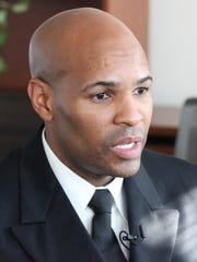 U.S. Surgeon General Jerome Adams during a 2017 interview in his office.