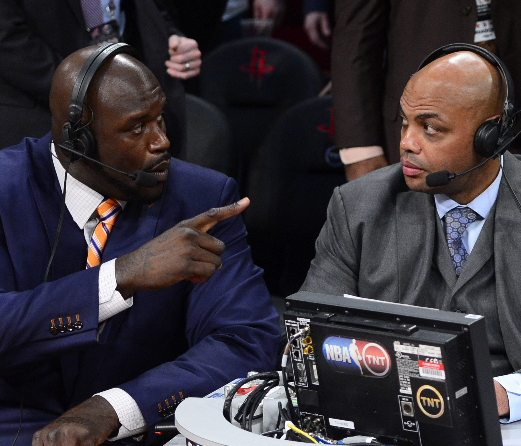Feb 16, 2013; Houston, TX, USA; TNT broadcaster Shaquille O'Neal (left) and Charles Barkley talk during the 2013 NBA All-Star slam dunk contest at the Toyota Center. Mandatory Credit: Bob Donnan-USA TODAY Sports ORG XMIT: USATSI-128540 ORIG FILE ID: