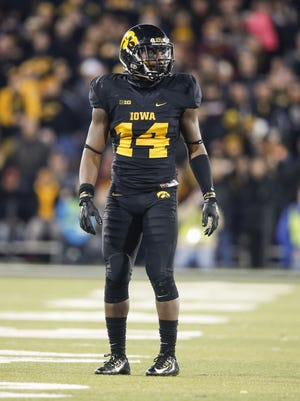 Iowa defensive back Desmond King waits for the ball as Minnesota prepares to punt on Saturday.