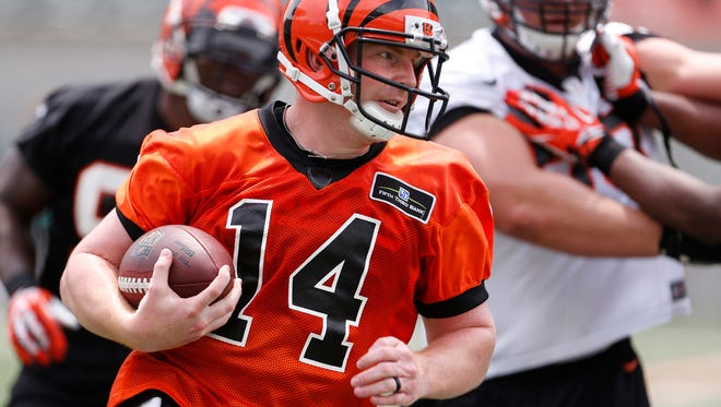 Bengals quarterback Andy Dalton runs with the ball during mini-camp in June.