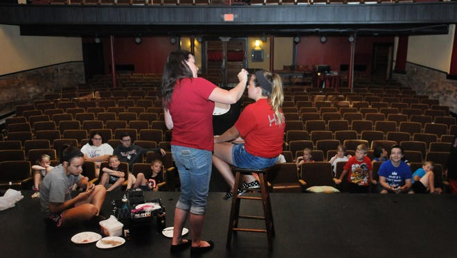 """Tina Kessinger, left, puts theater makeup on Emma Horick during Paxton Theatre Camp on Tuesday at Paxton Theatre in Bainbridge. Each day, campers learn a skill such as makeup, acting, lights and sounds, improvisation, and stage combat. Campers and other community members can audition for """"Disney's Alice in Wonderland Jr."""" on Friday at the theater."""
