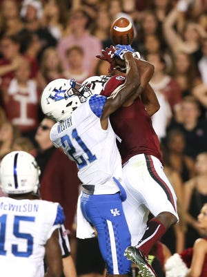 Kentucky Wildcats defensive back Chris Westry (21) breaks up a pass intended for South Carolina wide receiver Deebo Samuel in the first half of an NCAA college football game Saturday, Sept. 12, 2015, in Columbia, S.C. Kentucky won 26-22.