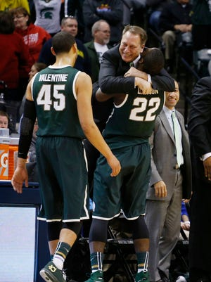 Michigan State Spartans coach Tom Izzo hugs guard Branden Dawson (22) after defeating the Michigan Wolverines in the championship game for the Big Ten college basketball tournament at Bankers Life Fieldhouse.