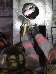 Carroll, Iowa, firefighters break apart a chimney to free a man who got stuck inside the night of May 17, 2016, apparently trying to break into Carroll Redemption Center, located in Carroll, Iowa. Jordan Kajewksi crawled into the chimney during the night of May 17, 2016, and was rescued the following day. He was naked and covered in soot, though he had his clothes with him. Kajewski was charged with trespassing. ()