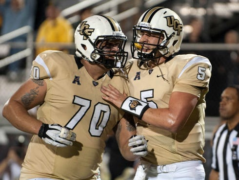 UCF Knights quarterback Blake Bortles (5) is congratulated on a touchdown run by offensive lineman Chris Martin (70) against the Rutgers Scarlet Knights at Bright House Networks Stadium.