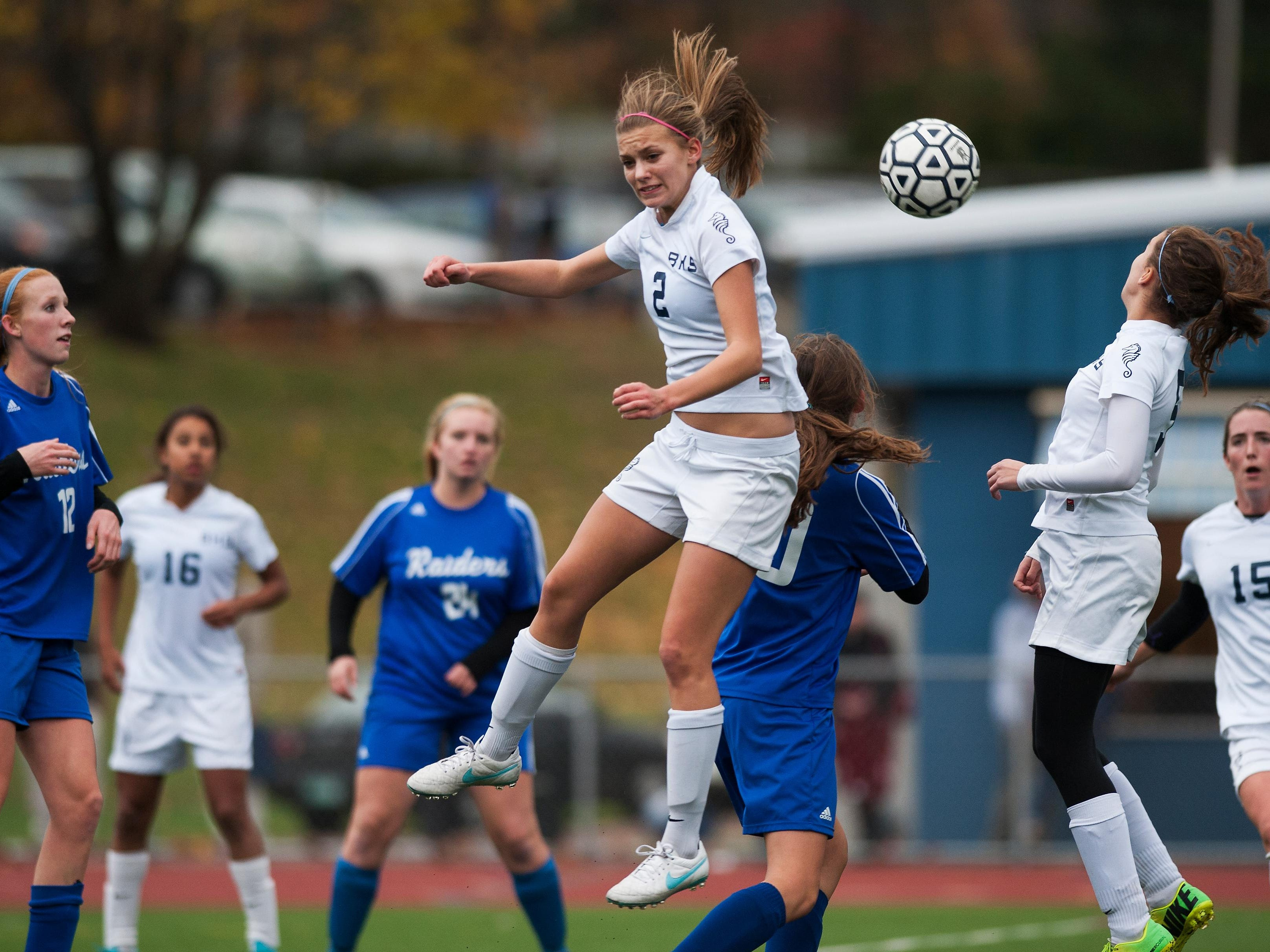 Burlington's Noe Musman (2) leaps to head the ball in front of the net during the girls playoff soccer game between the U-32 Raiders and the Burlington Sea Horses at Buck Hard Field in 2014.