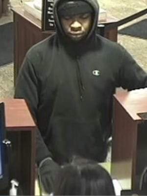 A surveillance photo of the suspect sought in the alleged bank robbery of the ESL branch on Merchants Road.
