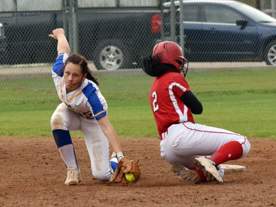 Tioga's Jade Fields (2, right) steals second ahead of Buckeye's Bobbi McNaughton's (15, left) tag.