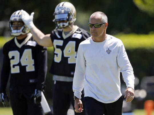 In this June 8, 2017, file photo, New Orleans Saints linebackers coach Mike Nolan walks on the field during NFL football practice in Metairie. Nolan, who has been coaching in the NFL since 1987, is in his first year as New Orleans' linebackers coach. He is trying to help improve a Saints defense that ranked 27th last season.