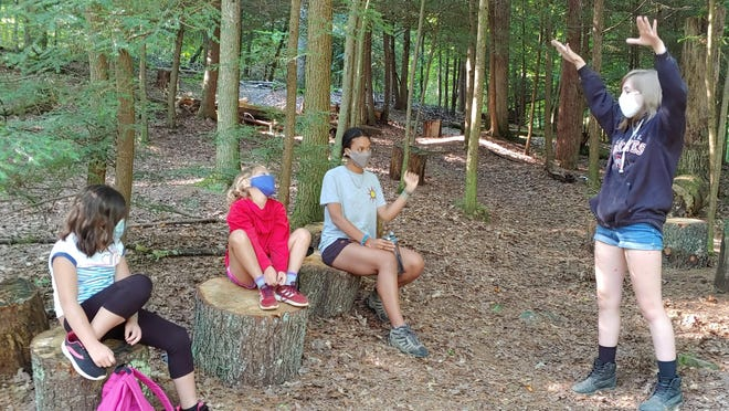 Campers and counselors at Camp Wyandot in Hocking County must wear masks except when eating, sleeping or out with their small cabin group. The camp also has half its usual number of children and has intensified cleaning.