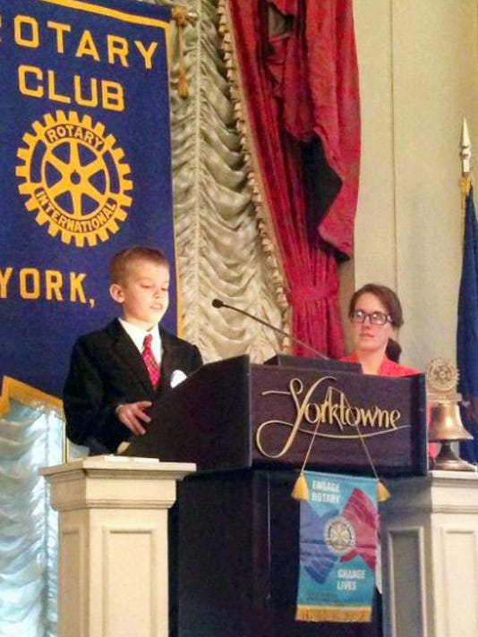 "Christian Bucks, who had the idea for a ""buddy bench,"" recently appeared at York Rotary."