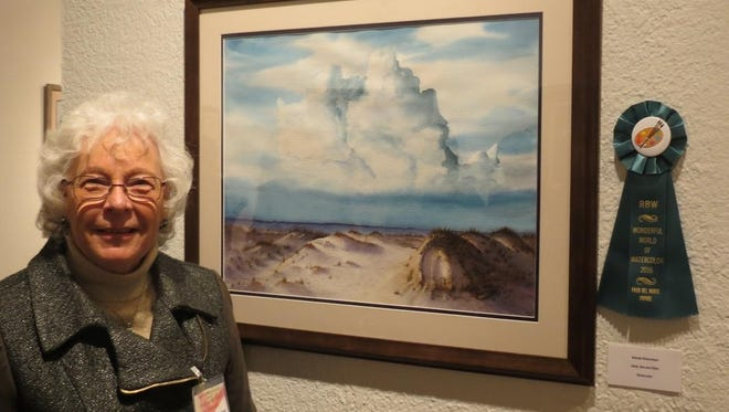 "Wanda Richardson with her ""Sand, Sea, and Skies,"" winner of the Paso Del Norte Award."