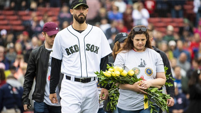 Rick Porcello of the Boston Red Sox escorts Vermont Gold Star family member Monica Merchant of Morrisville in the Memorial Day ceremony at Fenway Park. Monica was married to the late Chris Merchant, a member of the Vermont Army National Guard. Their childen Leighann Merchant and Dean Jones also attended along with Heather's partner, Michael Boucher.