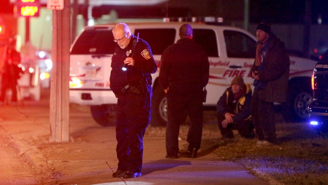 Police investigate the scene of a double shooting in North College Hill Saturday night. Two male juveniles were shot, both are expected to survive.