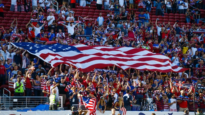 American fans wave a flag at the CONCACAF Gold Cup final in July.