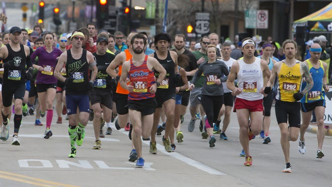 Runners start off the 2016 Oshkosh Marathon on Sunday, April 24, 2016, in downtown Oshkosh.