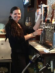 Caitlin Colquhoun of Long Valley tends bar at Redwoods
