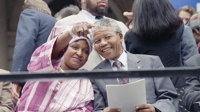 Winnie Mandela, left, points out something in the crowd to her husband, Nelson Mandela, on June 20, 1990, in New York's City Hall during a welcoming ceremony for the couple as they kicked of a three-day stay in the city.